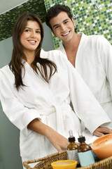 Hispanic couple wearing bathrobes