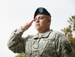 Hispanic soldier saluting