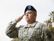 Hispanic soldier saluting