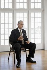 Caucasian businessman sitting in chair
