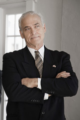 Caucasian businessman with arms crossed