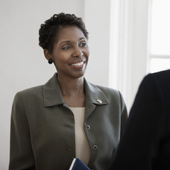 Black businesswoman talking to co-worker
