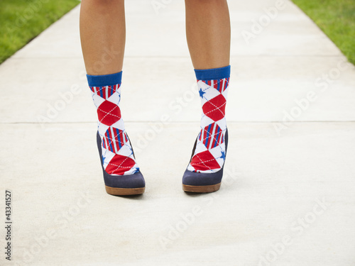 Close up of Asian woman in patterned socks and high heels