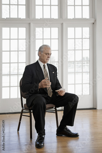 Caucasian businessman sitting in chair