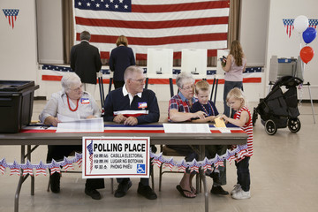 People working at polling place