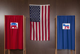 Voting booths and American flag in polling place