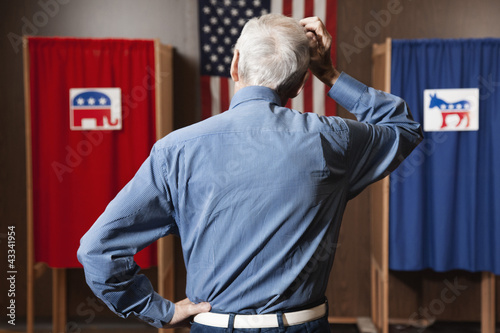 Caucasian voter waiting to vote in polling place