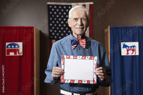 Caucasian voter holding blank card in polling place