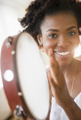 Black woman holding tambourine