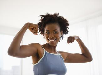 Black woman flexing biceps