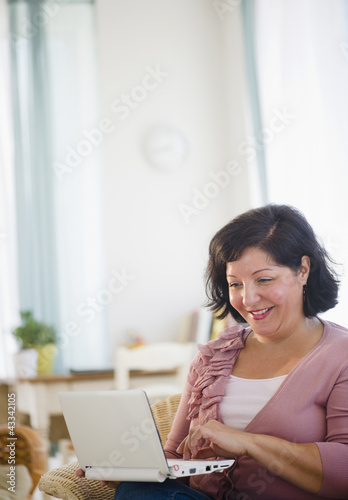 Hispanic woman using laptop