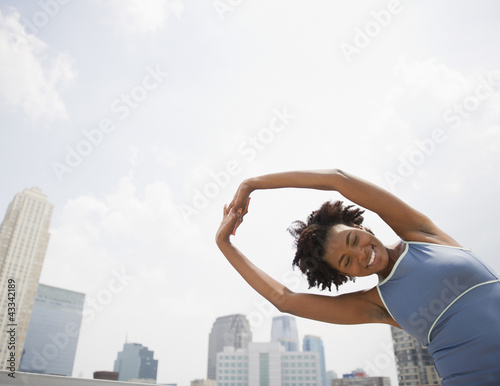 Black woman stretching before exercise