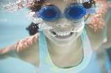 Hispanic girl swimming under water