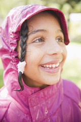 Smiling Hispanic girl in rain coat