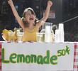 Cheering Caucasian girl operating lemonade stand