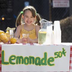 Caucasian girl operating lemonade stand