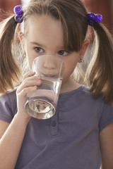Caucasian girl drinking water