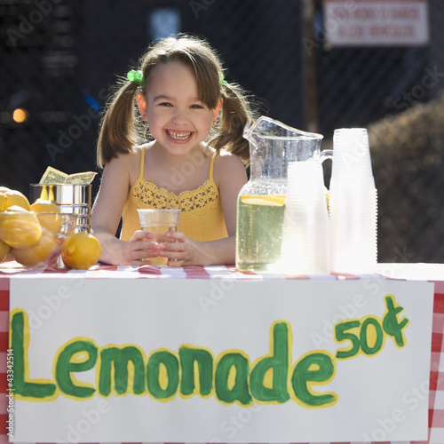 Caucasian girl operating lemonade stand