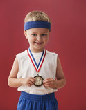 Caucasian boy wearing sports medal
