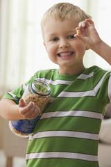 Caucasian boy holding up peanut