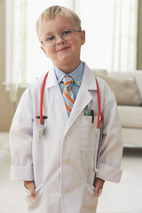 Caucasian boy in doctor's outfit