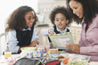 Mixed race mother going over homework with daughters