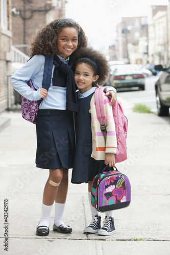 Mixed race sisters on the way to school