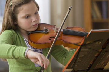 Caucasian girl playing violin