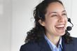 Hispanic businesswoman talking in headset