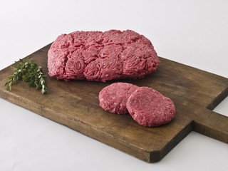 Raw hamburger meat on cutting board