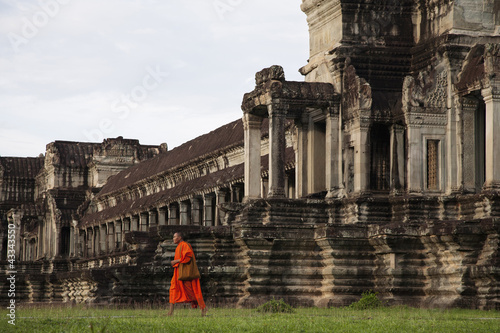 Priest walking near Angkor Wat temple