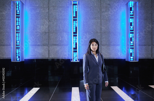 Asian businesswoman standing in lobby