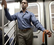 African American businessman on subway train