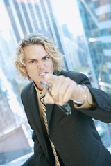 Angry Caucasian businessman pointing