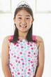 Smiling Chinese girl wearing tiara
