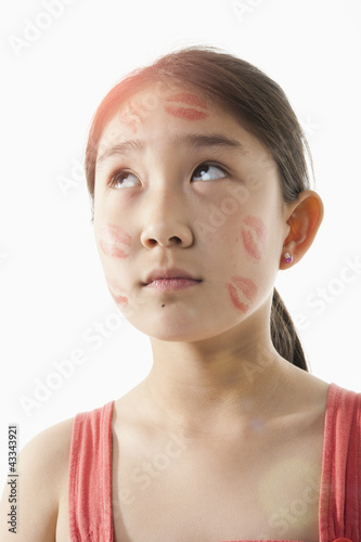 Chinese girl with lipstick kisses on her face