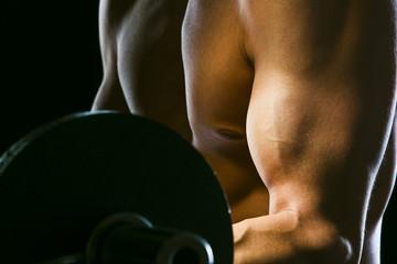 Caucasian man exercising with barbells