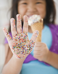 Korean girl with sprinkles on her hand