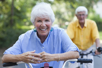 Senior Caucasian couple riding bicycles