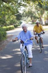 Senior Caucasian couple riding bicycles