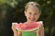 Girl holding wedge of watermelon