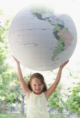 Girl holding large globe