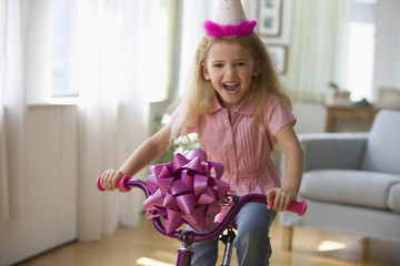 Caucasian girl with new bicycle