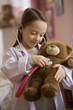Caucasian girl playing doctor