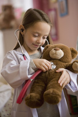 Caucasian girl playing doctor