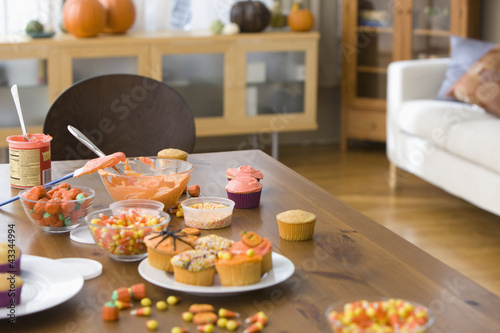 Table with cupcakes and candy decorations
