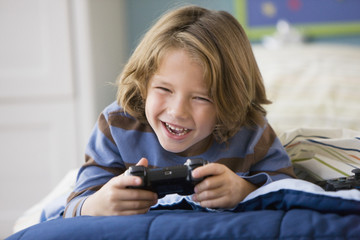 Caucasian boy playing video game