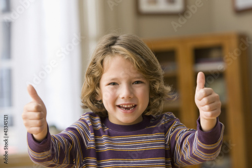 Caucasian boy giving thumbs up