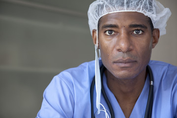 Black doctor in scrubs and surgical cap