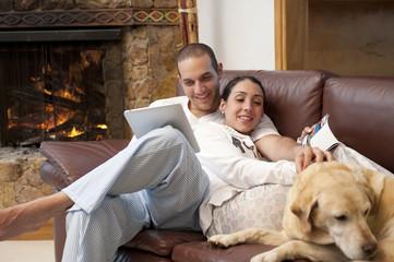 Hispanic couple relaxing on sofa together
